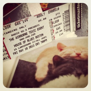 Tickets to see my favorite band inside a cat birthday card?